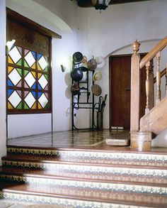 Diamond shaped blue, red, green, and yellow window panel lets light in the first floor. A hat stand is at the bottom of the staircase, used like days of old. Filipino Interior Design, Contemporary Interior Design, Interior Designing, Filipino Architecture, Philippine Architecture, Spanish House, Spanish Colonial, Indian Home Decor, Retro Home Decor