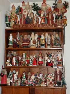 santa love...Looks like my collection except the display on the top of the cabinet...will do that this Christmas!