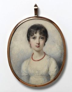 Curls framing the face, white muslin gown, and a coral necklace: the proper Regency lady