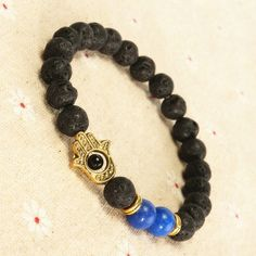 Check out Lava Rock w/Sea Sediment Stone Golden Hamsa Beaded Bracelet for $3.12. Get it on Shopee now! https://shopee.sg/wonderfulhouse.sg/105784485 #ShopeeSG