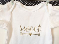 Sweet and arrows baby girl onesie, with shiny gold design.  - Carters, SIZE 3 MONTHS  - Garment pre-washed before applying vinyl  - Wash inside