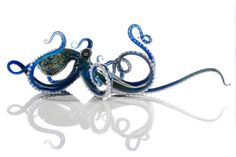 I would love to buy one of these! If it weren't $400!  Glass Octopus Sculpture by 2BirdsGallery on Etsy, $400.00