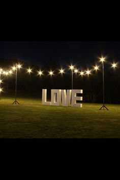 Large LOVE letters under festoon lights look pretty dam cool