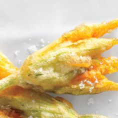 Crunchy, salty, and utterly addictive, fried zucchini blossoms make for a delicious starter.