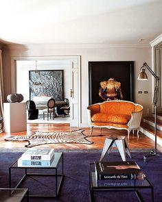 Living room settee, large art, zebra hide rug