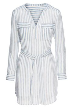 """This """"Spring City Shirt Dress"""" by Sanctuary in Laundry Stripe features two breast pockets, a v-neck cut, and a tie waist to adjust to your preference. Pair with booties and a denim jacket.   Spring City Shirt Dress by Sanctuary. Clothing - Dresses - Mini Nevada"""
