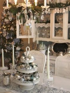 This three-tiered centerpiece combines silver ornament balls, sparkling starfish, strands of jewelry and holiday greenery while adding a creative and vintage touch to a cottage-style dining room. Design by HGTV fan single_mom_on_a_budget