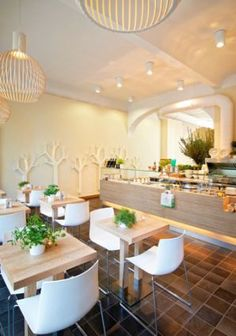 The white Octo 4240 pendants by Secto Design finishing the look of the healthy and fresh Dean & David restaurant in Hamburg, Germany. http://deananddavid.de/