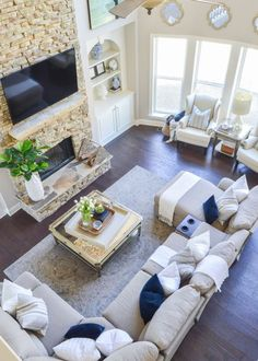 Decked and Styled Spring Home Tour - Kelley Nan- two story living room or great room with nottaway hickory hardwoof floors, stacked stone fireplace, and la-x-boy sectional. Big windows and blue and white decor wohnzimmer Decked and Styled Spring Home Tour Elegant Living Room, Cozy Living Rooms, Home Living Room, Living Room Designs, Modern Living, Small Living, Apartment Living, Apartment Design, Minimalist Living