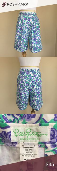 """✨Vintage✨ Lilly Pulitzer high waist shorts sz S Vintage Lilly Pulitzer early 80's era high waist floral shorts.  Tag says size 10, vintage sizing runs small and waist measures to approximately a size 4, please follow measurements for fit.  Zip and button closure, side pockets, front pleats, elastic inserts at hips for comfort movement.  Condition:  vintage excellent.  Material:  50% cotton/50% polyester.     Measurements (approximate, taken laying flat):  length 20.5"""", flat unstretched…"""