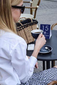Parisian look, coffee, straw basket, white shirt. More on afnewsletter.com