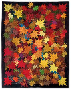 I love the depth in this quilt. See how the light coloured leaves seem to be in the foreground and the brown and red leaves recede? This is a fabulous example of colour value at work.