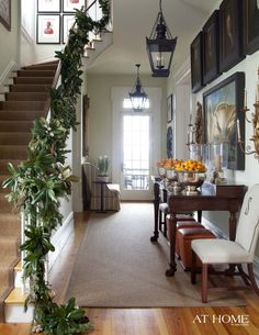 Christmas garland, stairway, silver bowls of oranges