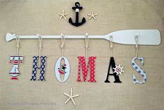 "58"" 6-Peg Painted Paddle Rack and Six 9"" Decorative Baby Name Letters & Rope /Navy Red Baby Blue White/Nautical Nursery Decor / Canoe Paddle #nautical #baby #babynamesign #nauticaldecor #personalizedbaby #canoepaddle #paddle #oar #oarpegrack #nauticalbaby #hangingletters #hangingbabyname #rustic"