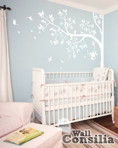 This beautiful white corner tree with birdcage and birds will make a perfect finishing touch for your living room. Indulge your little one's imagination with this stunning vinyl wall decal set perfect for any nursery or bedroom. We think it's a great choice for gender neutral nursery! This tree mural sticker features dreamy scene –what could a little kid love more?