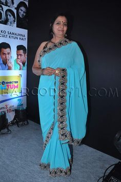 Light blue saree with embroidered border.