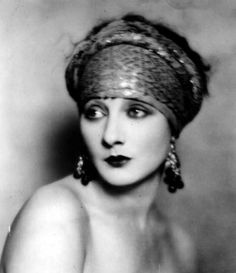 love this whole look! turbin, dark lip, gypsy jangle earrings...
