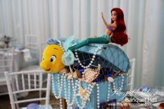 Little mermaid baptism centerpiece at Royal Palace Banquet Hall Glendale CA 818.502.3333.