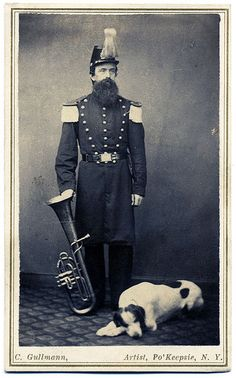 Tuba player with dog \