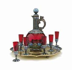 A SILVER-GILT AND CLOISONNÉ ENAMEL AND GLASS VODKA SET MARKED P. OVCHINNIKOV WITH THE IMPERIAL WARRANT, MOSCOW, CIRCA 1890