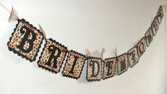 BRIDE TO BE - Black and Leopard Print Bachelorette Party Banner with Lingerie Tank Top. $19.95, via Etsy.