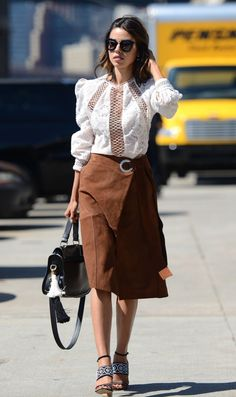 Annabelle Fleur wearing a Victorian-inspired blouse and suede skirt during NYFW.