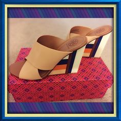 """Authentic Tory Burch Mule wedges  It features crisscross leather bands resting on a high blocky heel, tiled with strips of wood and acrylic. One of Tory's favorites of the season, it delivers flattering height and a unique mix of materials in one striking architectural design.Upper;leather lining; leather sole Made in Brazil Runs true to size Open toe; slip on Criss cross straps over vamp Lacquered color block 3.98"""" inches wood wedge. Very beautiful trade lowballs thank you  Tory Burch Shoes…"""