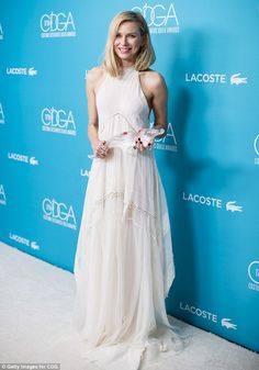 Whimsical Watts! Naomi is the epitome of ethereal beauty in a sweeping boho white dress as she is honoured at the Costume Designers Guild Awards on Tuesday night