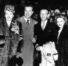 Lucille Ball, Dick Powell, Fred Astaire, and Judy Garland pose for a photo along the way of a war bond tour in 1943.