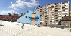 side view from rooftops, whale mural by nevercrew, 3d street art