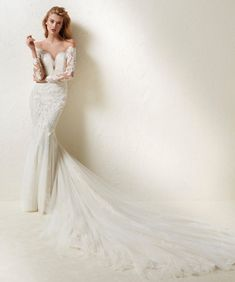 Pronovias | Sensual & feminine, this mermaid wedding dress features a tattoo-effect long sleeves & cathedral train!