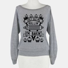 "Show your love for the culinary art of baking with this cute cupcake shirt. This graphic tee features an illustration of a rolling pin, cupcakes, and the phrase ""They See Me Rollin I'm Bakin.""... 