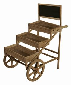 Add a fascinating flourish to the living room with this rugged wooden cart.