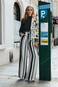 Olivia Palermo s Mix Matched Spring Outfit White And Black Wide Striped  Legged Trousers With Striped Blouse c38364754