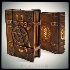 Ankh journal... custom ordered; 9 x 7 inches size; carefully combined symbols; straps for locking journal; hand toned leather; several gilding; etc. ______ http://www.alexlibris-bookart.com