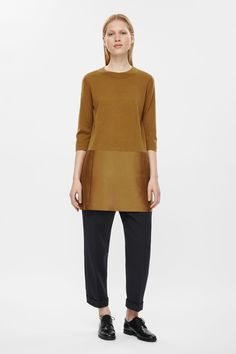 This dress is made from a fine knit merino wool top and a contrasting wool-silk skirt with a subtle sheen. A relaxed fit, it has large slit pockets, 3/4 sleeves and neat finishes.