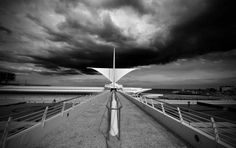 The Milwaukee Art Museum keeps the wings of the Calatrava's Quadracci Pavilion open while a storm passes over. If you dislike the photo could you please provide some constructive feedback to make it better? Milwaukee Art Museum, Santiago Calatrava, Wind Turbine, Places Ive Been, Beautiful
