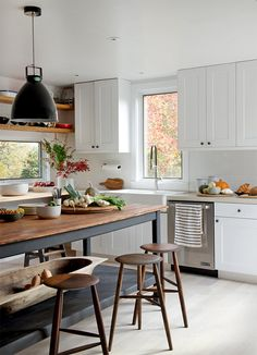 Can use an interesting table to seperate kitchen from other areas if an Island is to pricey!