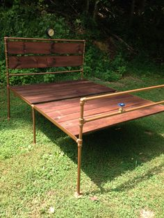 Industrial platform bed built with 3/4 pipe and 1x6 lumber and circa 1900 steam pressure gauge