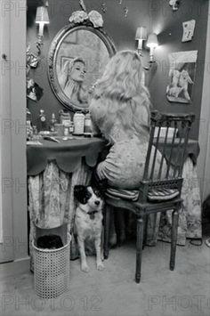 Brigitte Bardot at home with her dog Guapa, 1958