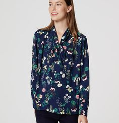 Vibrant florals meet a femme tie neck and flowy fit for a piece that wraps it all up - beautifully. V-neck with ties. Long sleeves with button cuffs. Shirred beneath shoulders and back yoke. Shirttail hem.