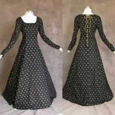 Dress description: Inspired by the styles of the Middle Ages and Renaissance, this long, full gown is made fromblack poly/cotton blend featuring agold-colored Fleur De Lis pattern (print) on the black gown.