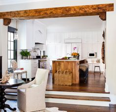 Wooden beam as kitchen/eating area divider.
