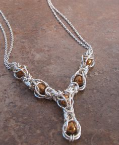 Sterling silver Byzantine caged bronze Swarovski pearl chainmaille necklace. $185.00, via Etsy.