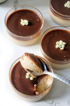 4 hours · Serves 6 · Rich and creamy coffee (espresso) flavoured panna cotta recipe. Made with cream, vegetarian genaltine (or agar agar) in simple easy steps and topped with a rich chocolate layer. Köstliche Desserts, Chocolate Desserts, Delicious Desserts, Plated Desserts, Paleo Dessert, Dessert Recipes, Chocolate Topping, Chocolate Coffee, Coffee Dessert