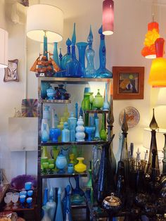 End of History shop, New York, via Flickr. (midcentury glass, design, decor, blenko, holmgaard, blue, green)