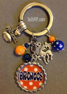 Denver Broncos inspired bottle cap key chain, NFL, football, sports, bling, blue and orange, team spirit, horse, gift, fantasy football. $16.00, via Etsy.