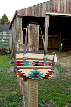 Saddle blanket bag. Conchos and horse hair zipper pull!