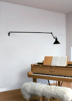 wall lamp over the piano