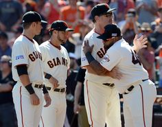 San Francisco Giants' Pablo Sandoval (48) hugs manager Bruce Bochy as the Giants team is announced before the start of Game 3 of baseball's NL Division Series against the Washington Nationals at AT&T Park in San Francisco, Calif., on Monday, Oct. 6, 2014. (Susan Tripp Pollard/Bay Area News Group)